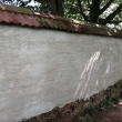 Applying Scratch Coat to Cob Wall